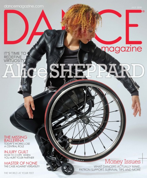Image Description: Alice Sheppard in black leather jacket and metal studded boots balances on the tip of her footplate as she twists sideways to frame the rims of her wheelchair with her fingertips. Her face is in profile calmly focused. Her red and orange highlighted hair pops with the red stripe in her wheels and the red Dance Magazine title. Headline on the magazine cover reads: It's time to redefine virtuosity: Alice Sheppard. Photo by Jayme Thornton.