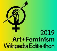 A female gender symbol with a raised fist holding an artist paintbrush. Text reads 2019 Art + Feminism Wikipedia Edit-a-thon.
